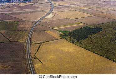 aerial view of highway and field.