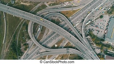 Aerial view of highway and overpass in city.