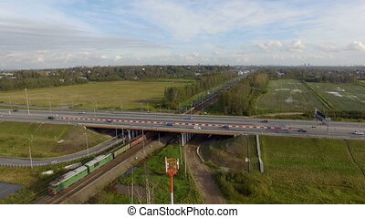 Aerial view of highway and railroad track. Rail riding...