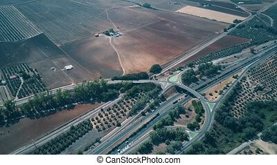 Aerial view of highway interchange and agricultural scenery,...