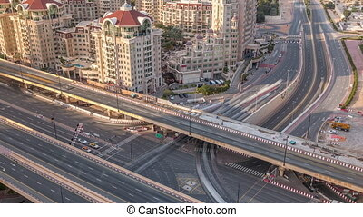 Aerial view of highway interchange in Dubai downtown evening timelapse.