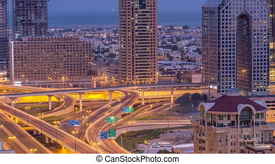 Aerial view of highway interchange in Dubai downtown night...