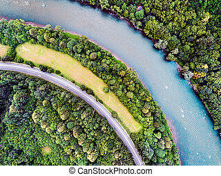 Aerial view of highway, river, forest and grassland