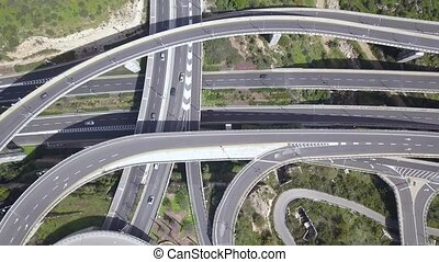 Aerial view of highway road, interchange and overpass in city. High quality 4k footage