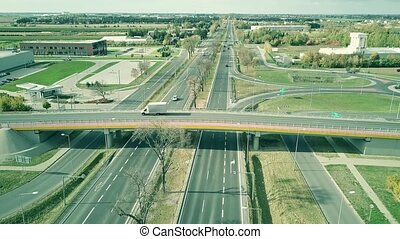 Aerial view of highway traffic on a sunny day