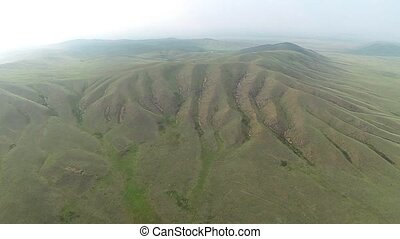 Aerial view of hills with green grass.