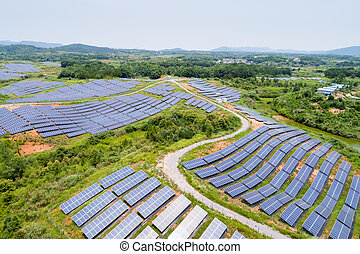 solar power station on hillside, aerial view of green energy