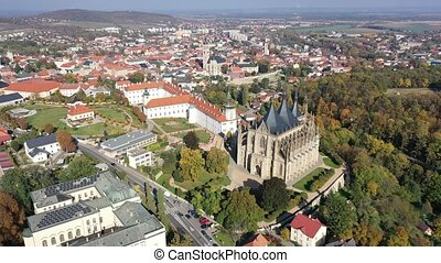 Autumn cityscape of Kutna Hora with famous gothic Roman Catholic church of Saint Barbara and Baroque building of Jesuit College, Czech Republic