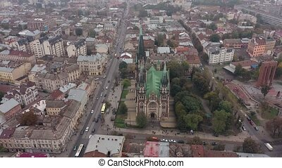 Aerial view of historical center of Church of Saints Olga and Elizabeth old gothic temple in town Lviv, Ukraine. Flying by drone over dome. 4k footage of landmarks, architecture of european Lvov city