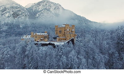 Aerial view of Hohenschwangau Castle at sunrise in winter...