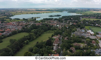 Aerial view of Hornsea Mere, the largest freshwater lake in ...