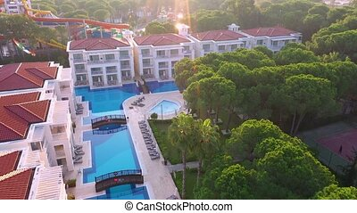 Aerial view of hotel with big swimming pool.