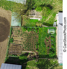 aerial view of household and field in the spring. Romania