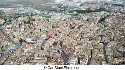view of Huesca cityscape with Gothic cathedral and bullring...