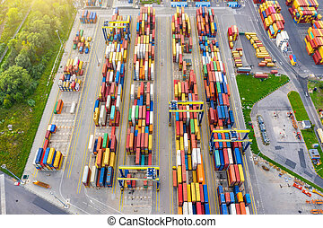 Aerial view of huge area with stacked cargo containers at the port.
