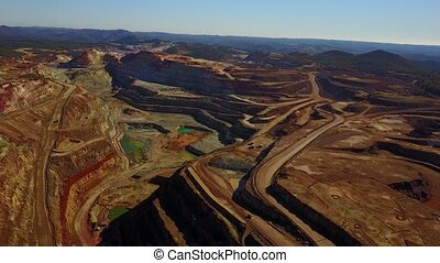 Aerial view of huge, modern open pit mine in Minas de...