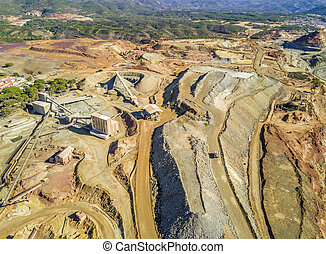Aerial view of huge, open pit mine with industrial architecture