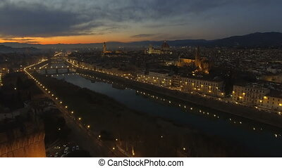Aerial view of illuminated Florence, Italy at sunset....