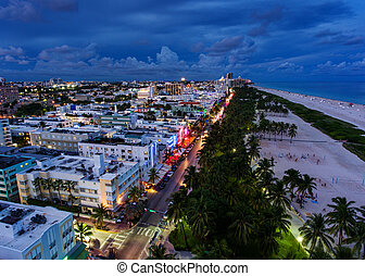 Aerial view of illuminated Ocean Drive and South beach,...