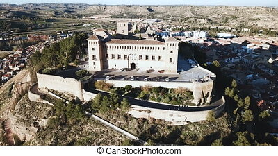 Aerial view of impressive medieval castle of Order of Calatrava on hill in town of Alcaniz, Spain