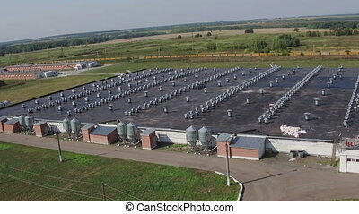 Aerial view of industrial poultry house in field - Aerial...