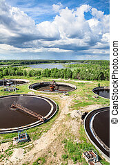 Aerial view of industrial sewage treatment plant with round settlers