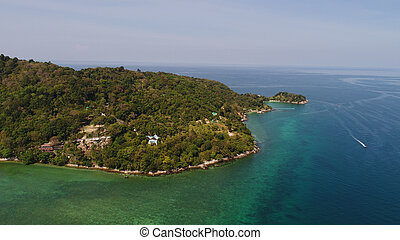 Aerial view of island coastline with rocks and sea water around