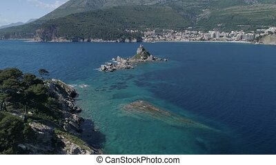 Aerial view of island with church in front of Petrovac.