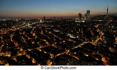Aerial view of Istanbul cityscape downtown in Turkey at night, time lapse.