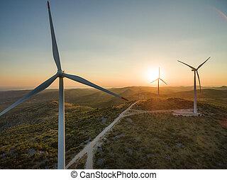 Aerial view of Jelinak windmill farm at sunset, Croatia.