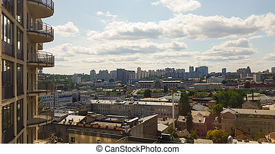 Aerial view of Kiev region with a modern city building mixed with historical, beautiful light at golden hour. City skyline of Kiev city from a bird's flight. Background image.