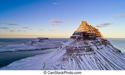 Aerial view of Kirkjufell mountain in winter, Iceland.