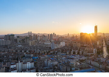 kunming cityscape in sunset - aerial view of kunming ...