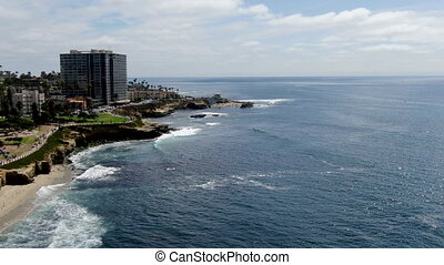Aerial view of La Jolla cove and coast, small picturesque beach surrounded by cliffs, San Diego