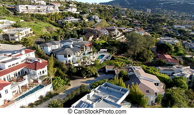 Aerial view of La Jolla little coastline city with wealthy villas and swimming pool.