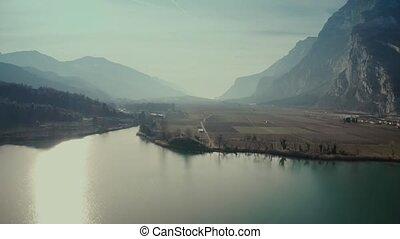 Aerial view of Lago di Toblino Lake and surrounding...