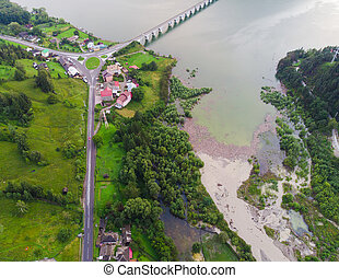 aerial view of lake and bridge after flood. Bicaz, Romania