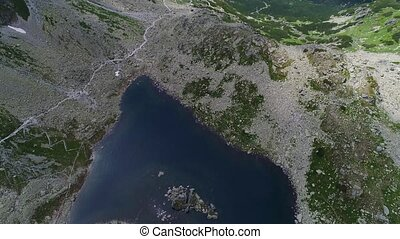 aerial view of lake in mountains