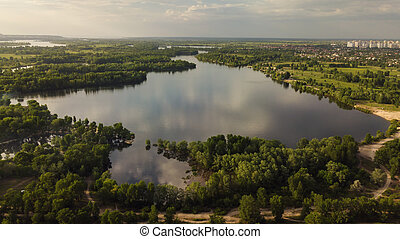 Aerial view of lake in the city. Spring.