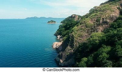 Blue waters of Lake Malawi at Monkey Bay. Aerial panorama.