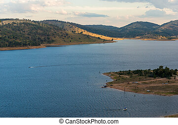Aerial View Of Lake With Hills On Sunset