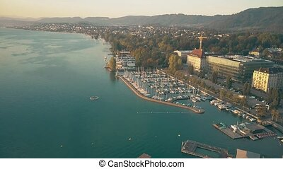 Aerial view of lake Zurich marina and moored boats....