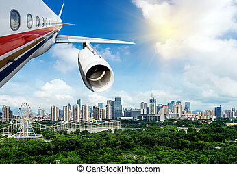 Aerial view of large cities - Modern aircraft flying over...
