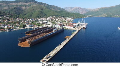 Aerial view of large floating dry dock for ship repairs in...