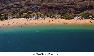 Aerial view of Las Teresitas beach, road, cars in the parking lot, golden sand beach and the Atlantic Ocean. Tenerife, Canary Islands, Spain