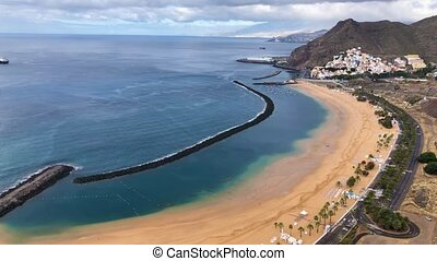 Aerial view of Las Teresitas beach without people and the surrounding landscape in the morning, Tenerife, Canaries, Spain. Timelapse