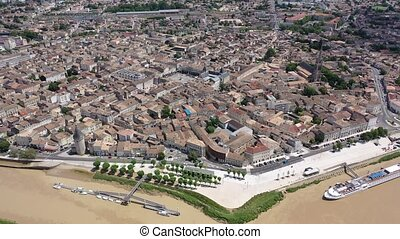 Panoramic aerial view of Libourne city on Dordogne river on sunny summer day, Gironde, France