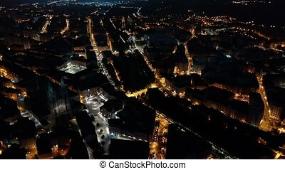 Picturesque aerial view of night Burgos cityscape overlooking Gothic steeples of Cathedral of Saint Mary, Spain
