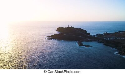 Aerial view of lighthouse during sunset