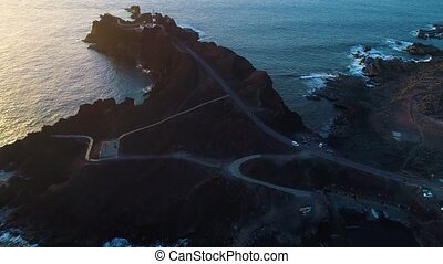 Aerial view of lighthouse during sunset - Aerial view of...